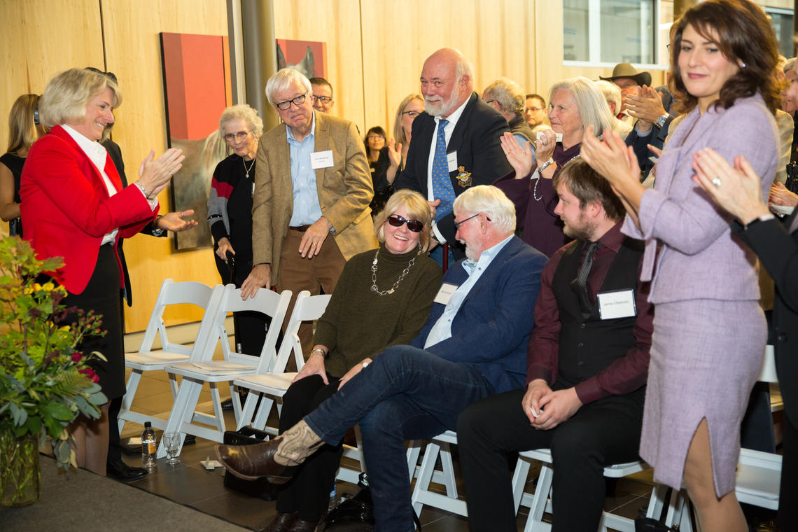 An appreciative audience at the Faculty of Veterinary Medicine Spy Hill Campus applauds the Anderson and Chisholm families for their generation donation.